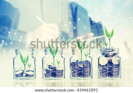 Double exposure of success businessman using digital tablet with coins with seed in clear bottle,Business investment growth concept,saving concept on city landscape background.Forex graph - stock photo
