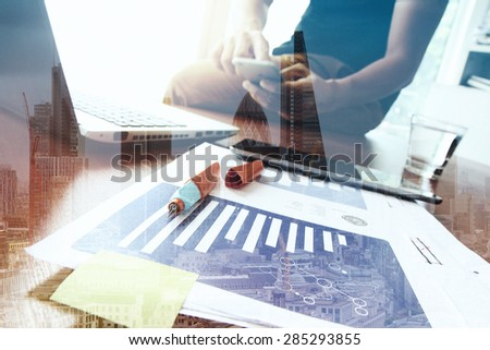 Double exposure of success businessman using smart phone with abstract building - stock photo