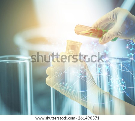 Double exposure of Test tubes close-up in scientist hand,Laboratory research - stock photo