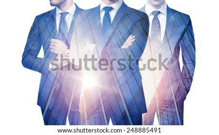 Double exposure of three businessmen and skyscraper