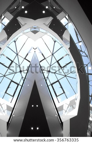 Double exposure of transparent dome roof / ceiling. Realistic photo of contemporary civil architecture with massive glazing, but far from real one. - stock photo