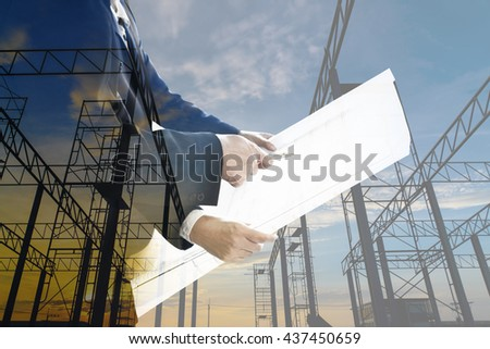 Double Exposure of two architect looking blueprint. - stock photo