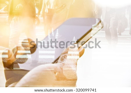 Double exposure of using smart phone and people walking on street background - stock photo