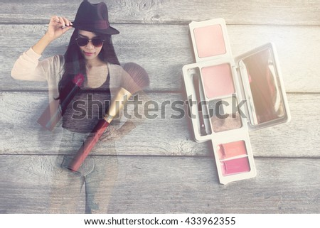 Double exposure of Vintage,Women wearing sunglasses and hat and Makeup brush and cosmetics on wooden table background.Double exposure effects - stock photo
