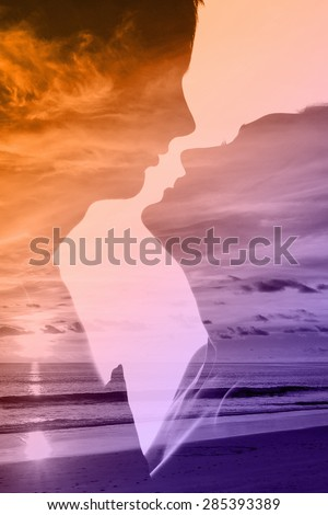 Double exposure of young beautiful loving couple and the sea at sunset - stock photo