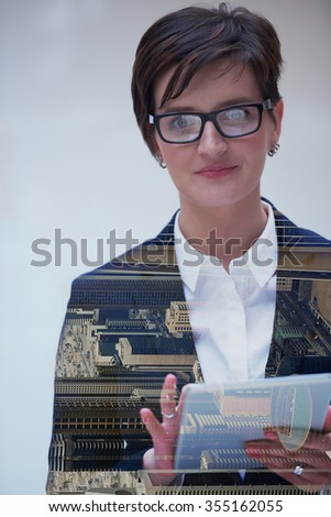 double exposure of young business woman working on tablet computer at office