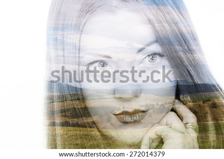 Double exposure photo of a young woman and mountain landscape - stock photo