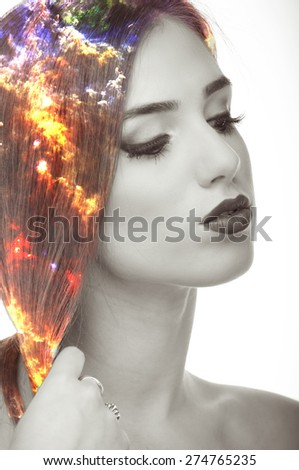 Double exposure photo of nebula and young woman portrait - stock photo