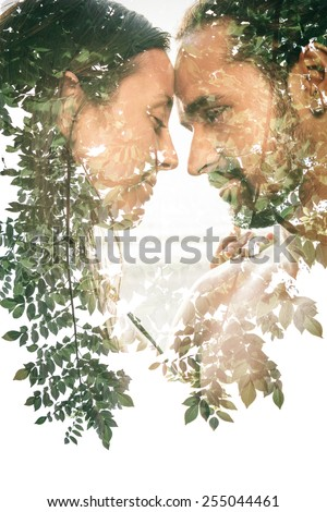 Double exposure portrait of a couple combined with photograph of nature - stock photo