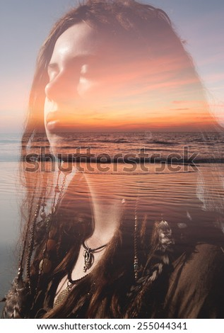 Double exposure portrait of a girl with ginger drealocks combined with photograph of sunset - stock photo