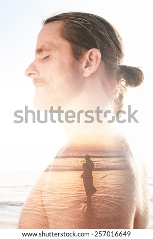 Double exposure portrait of a man remembering good times - stock photo