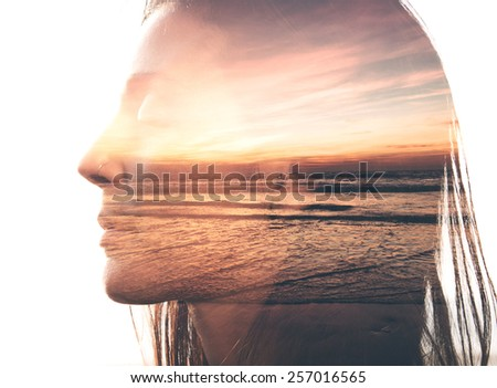 Double exposure portrait of a woman combined with photograph of nature - stock photo