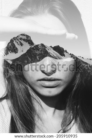 Double exposure portrait of attractive girl combined with photograph of snowy mountain - stock photo