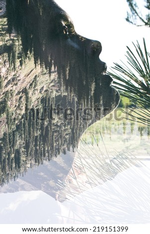 Double exposure portrait of attractive lady combined with mountainous landscape - stock photo