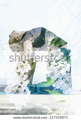 Double exposure portrait of attractive woman performing yoga asana combined with photograph of lilac flowers. - stock photo