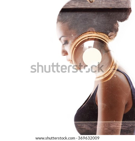 Double exposure portrait of beautiful woman and vintage photo camera. Beauty portrait of young mulatto woman in profile with retro photograph camera over white. - stock photo