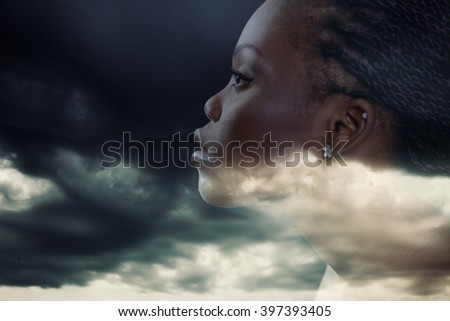 Double exposure portrait of beautiful woman. Beauty portrait of young african woman in profile with storm cloudy sky - stock photo