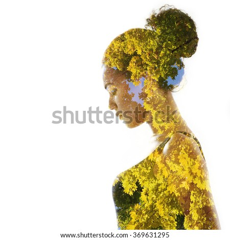 Double exposure portrait of beautiful woman. Beauty portrait of young mulatto woman in profile with autumn tree over white. - stock photo