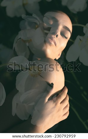 Double exposure portrait of gorgeous lady combined with photograph of white flowers in a sensual composition. - stock photo