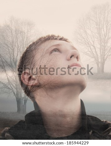 Double exposure portrait of young man - stock photo