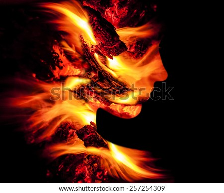 Double exposure portrait of young woman and fire. - stock photo