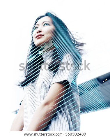 Double exposure portrait with beautiful Asian business woman and modern skyscraper - stock photo