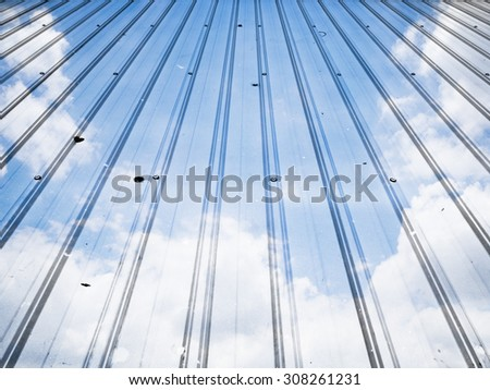 double exposure  roof tile and  blue sky background