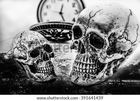 Double exposure skulls couple with vintage pocket watch ,Concept love and time blaiteck and wh - stock photo