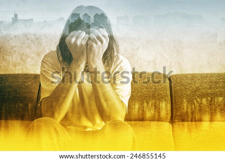 Double exposure, Social Alienation Concept, Depressed Man covering face and crying in despair. - stock photo