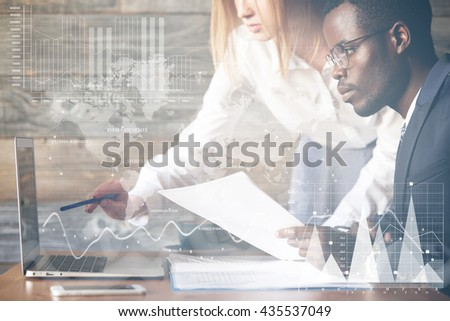 Double exposure. Visual effects. Two colleagues working together on business project using laptop: Caucasian woman holding a pen, pointing at diagrams and graphics on futuristic screen interface - stock photo