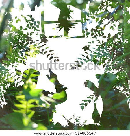 Double exposure with drinking people - beside the old house, down in the grass - stock photo