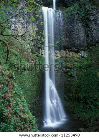 Double falls tumbles down a cliff in Silver Falls State Park Oregon USA