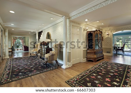 Double foyer in luxury home with white column - stock photo