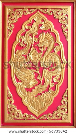 Double golden dragon in chinese style. On red wood. - stock photo