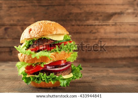 Double hamburger on wooden background