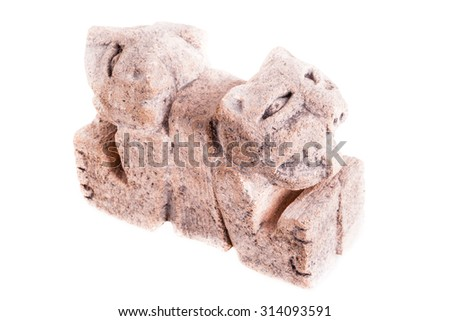 double head jaguar statue of chichen itza reproduction isolated over a white background - stock photo