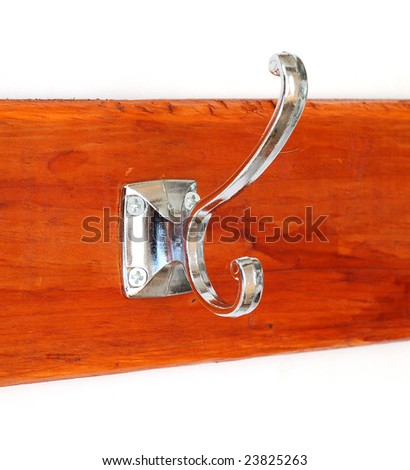 Double Hook for clothes on a wooden board - stock photo