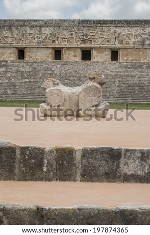 Double Jaguar headed Mayan Deity This enigmatic Mayan sculpture is found in one of the courtyards in Uxmal ruins in Yucatan, Mexico and was intended as a chair for the ruler.  - stock photo