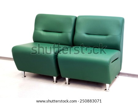 Double leather green sofa for office - stock photo
