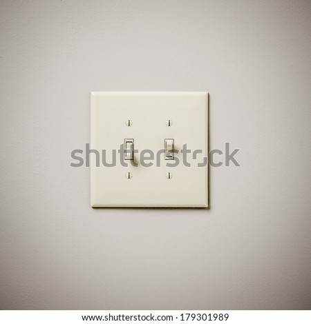 Double Lightswitch on White Wall On and Off - stock photo