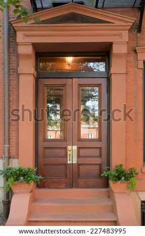 Double natural wood front doors with windows in brownstone for Natural wood front door