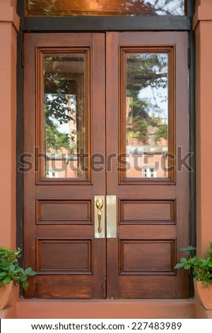 Double door stock photos images pictures shutterstock for Natural wood front door