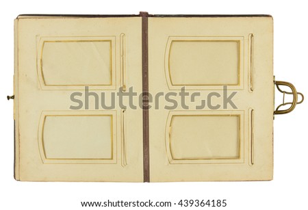 Double page of vintage photo album (circa 1900) with clasp and four frames for inserting photos, isolated on white background, contains clipping paths for all elements including photo frames