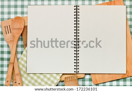Double page spread blank ring binder with copy space. Great recipes backdrop on a green gingham table top with kitchen equipment surround. - stock photo