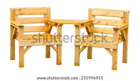 Double patio seating made from pine a popular soft wood often used for garden furniture. - stock photo