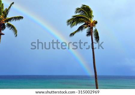 Double rainbow across the ocean of Maui, Hawaii  - stock photo