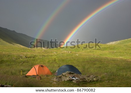 double rainbow at campsite - stock photo