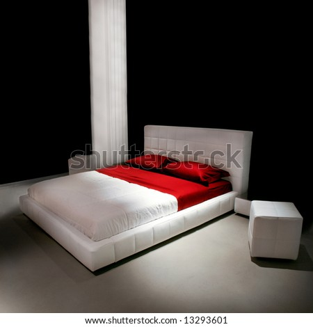 Double red and white bed in big bedroom - stock photo
