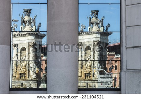 Double Reflection the monument of the Placa de Espana