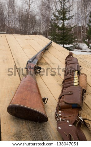 Double Shotgun and cartridge belt - stock photo